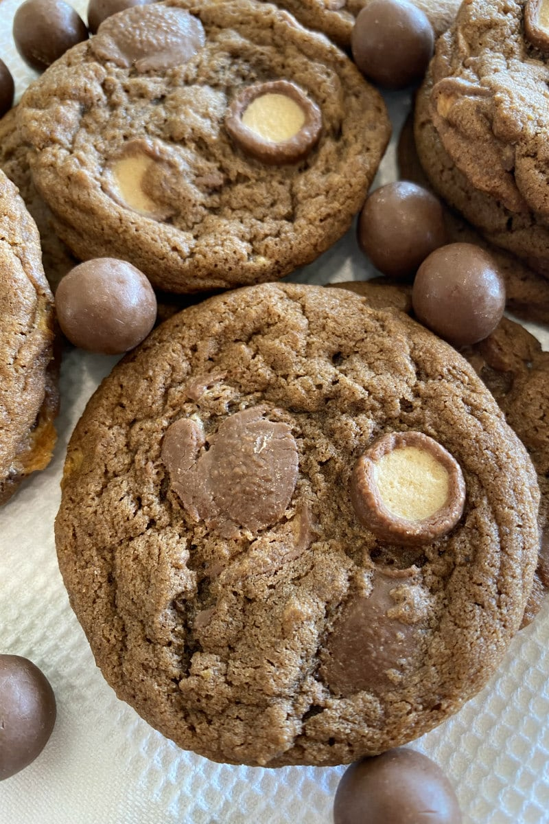 malted milk cookies with malt balls scattered around