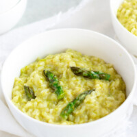 asparagus risotto in white bowl