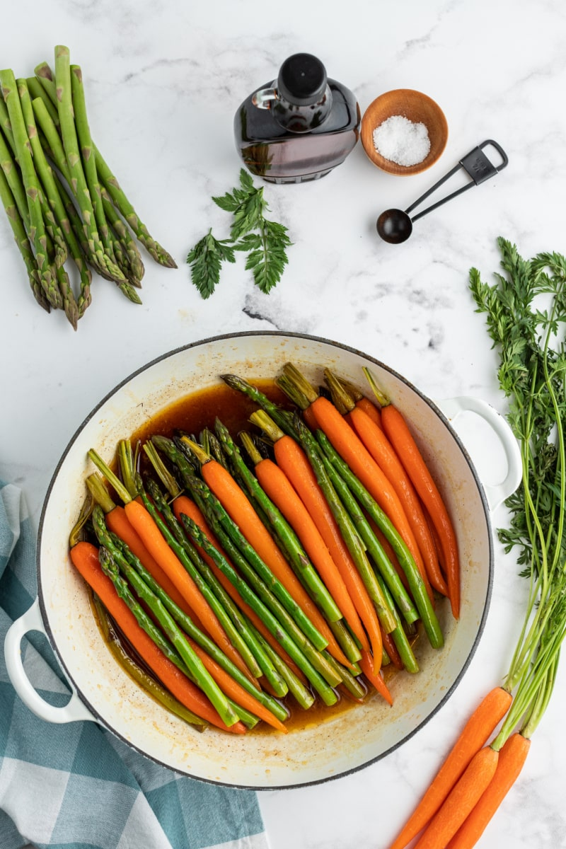 carrots and asparagus cooking in maple butter sauce