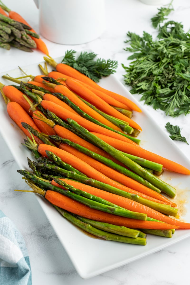 asparagus and carrots on white platter
