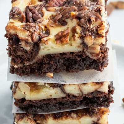 stack of three cream cheese swirl brownies