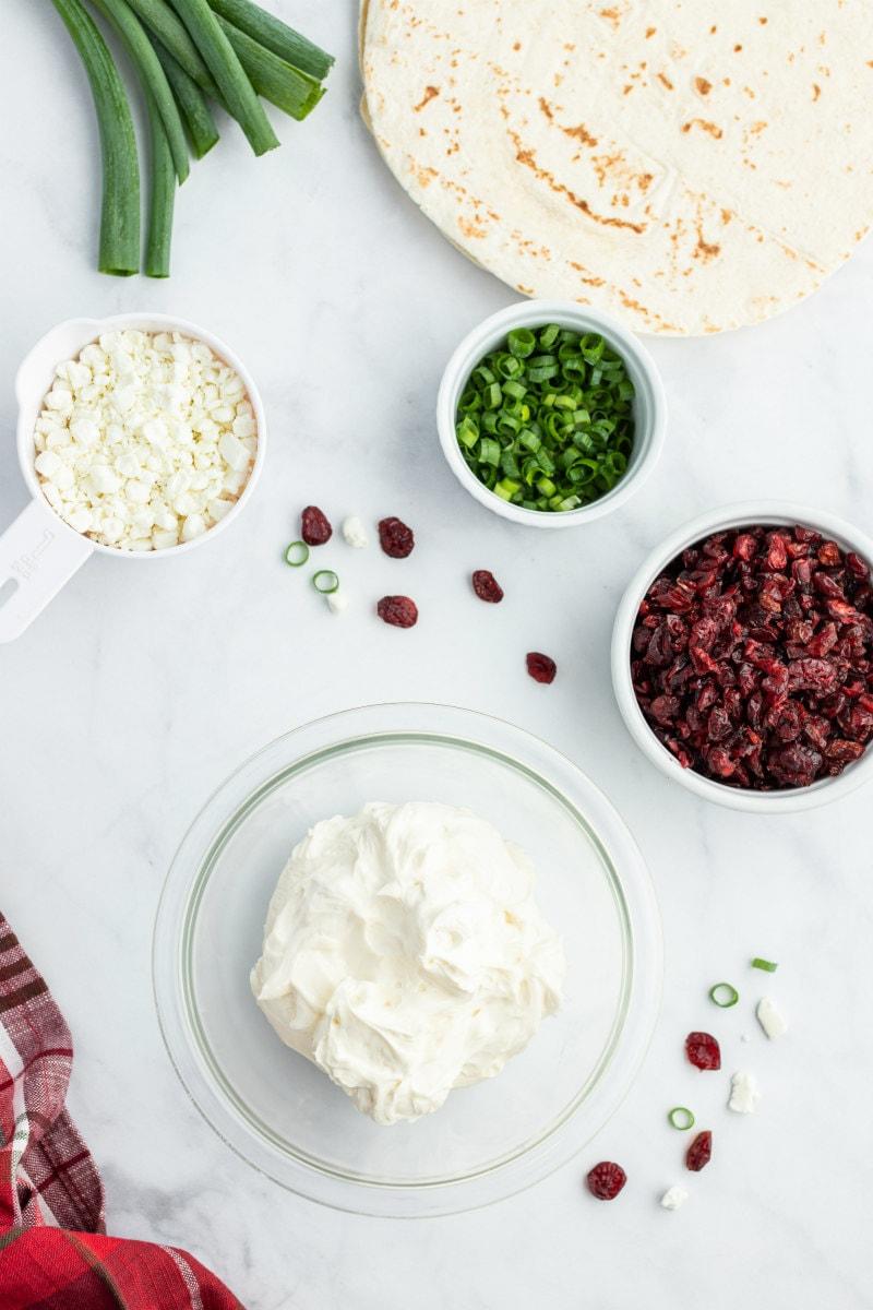 ingredients displayed for making cranberry feta pinwheels