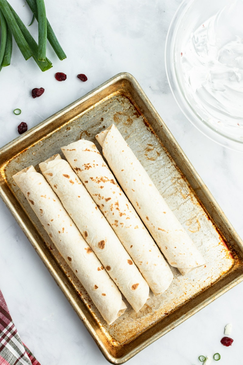 rolled up tortillas displayed for cranberry feta pinwheels