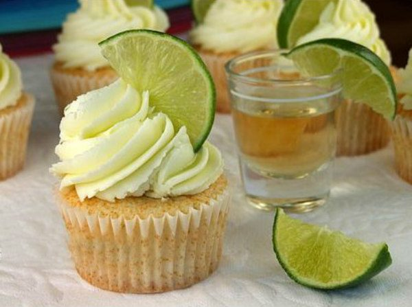 Margarita Cupcakes garnished with lime slices and tequila shots