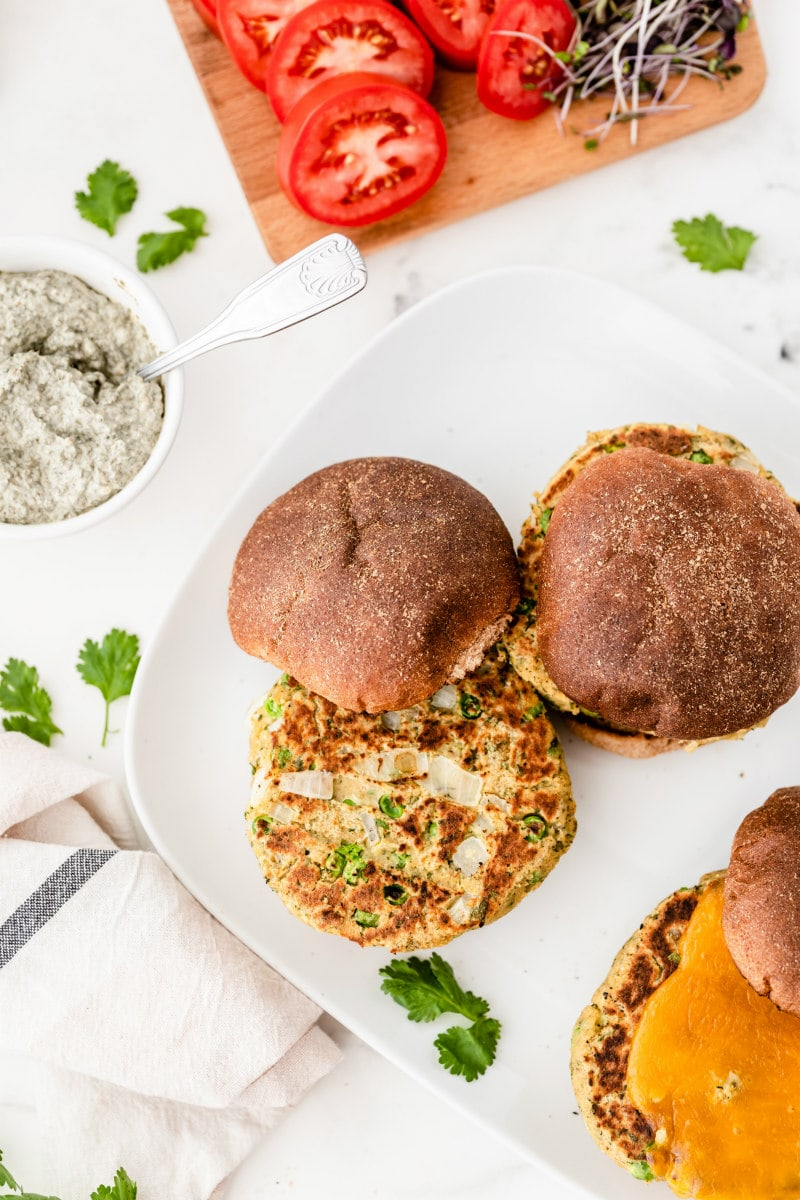veggie burger with fun on white plate with no condiments