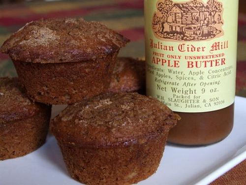 apple butter muffins next to a jar of apple butter