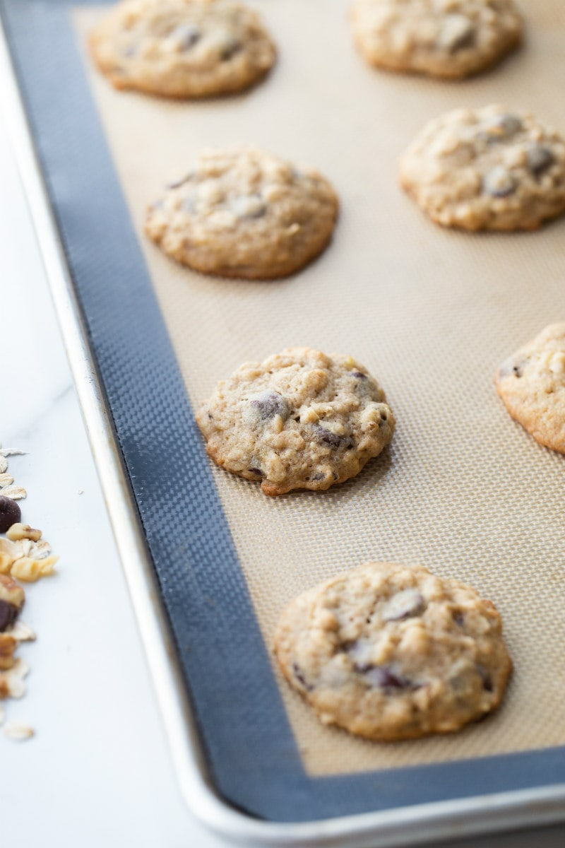 banana walnut chocolate chip cookies just out of the oven on a baking sheet