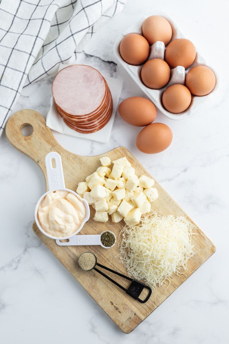 ingredients displayed for making brie and canadian bacon quiche