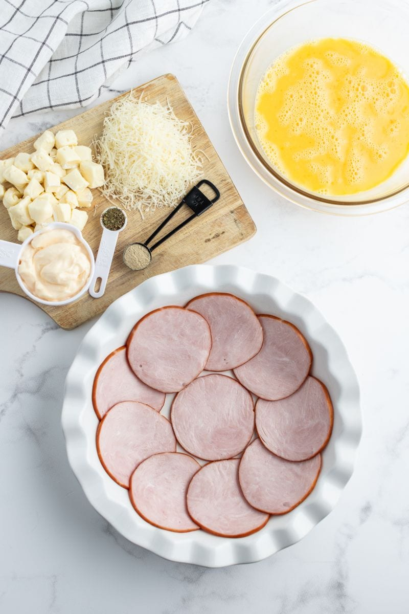 canadian bacon lined pie plate ready for making quiche