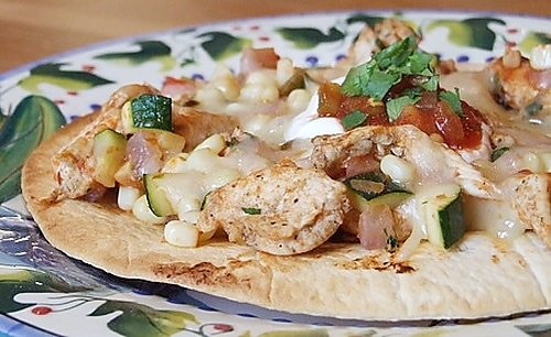 Chicken and Summer Vegetable Tostada on a colorful Mexican print plate