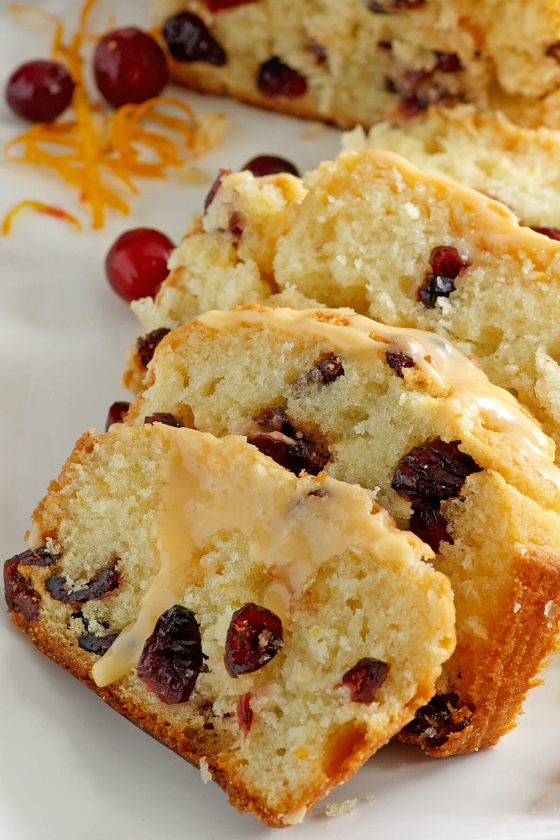 Cranberry Orange Bread with Grand Marnier Glaze curt into slices
