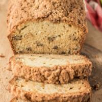 loaf of dutch apple bread on cutting board sliced
