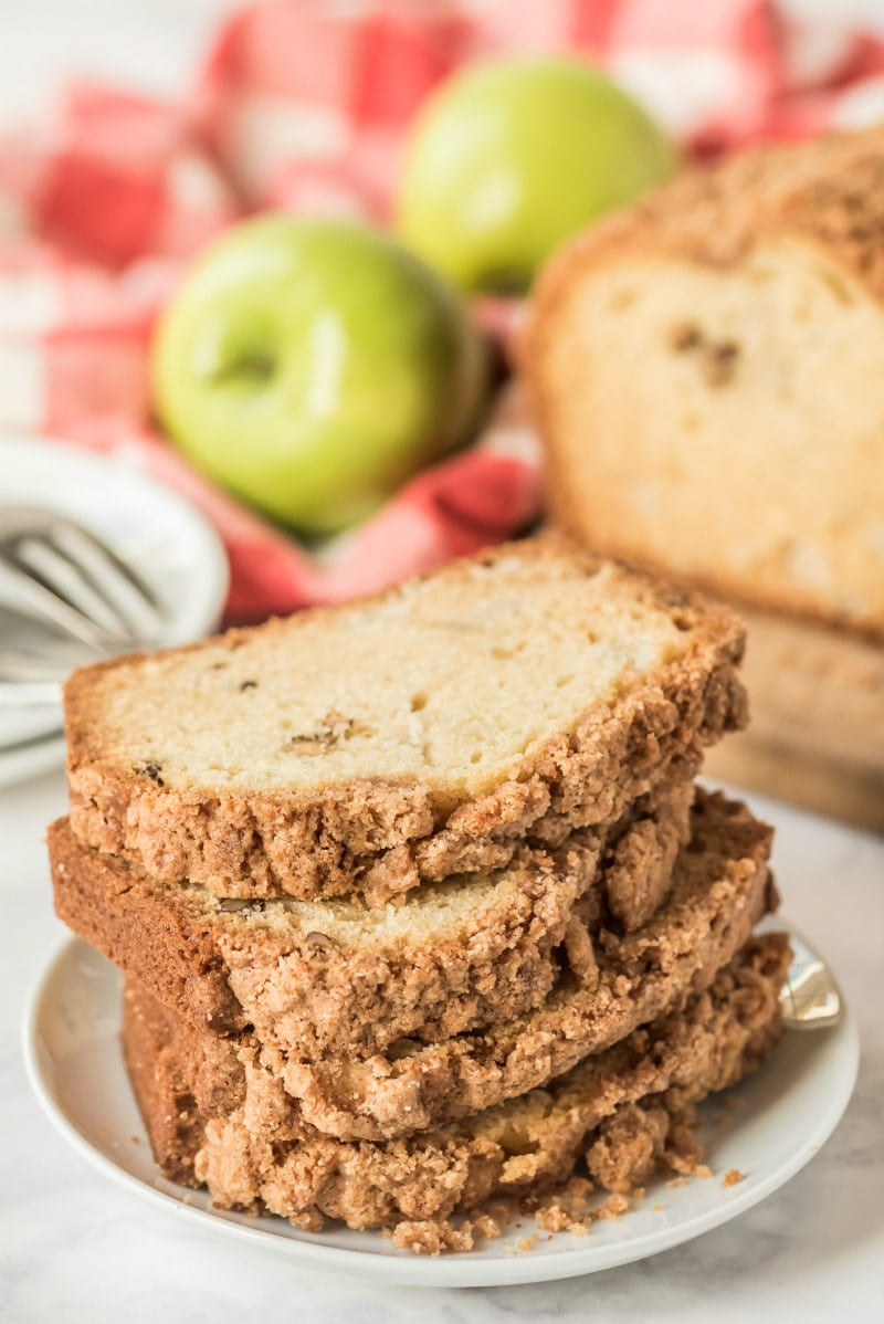 slices of apple bread stacked on a white plate