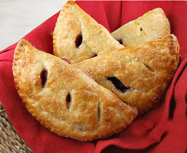 cherry turnovers in a red cloth lined basket