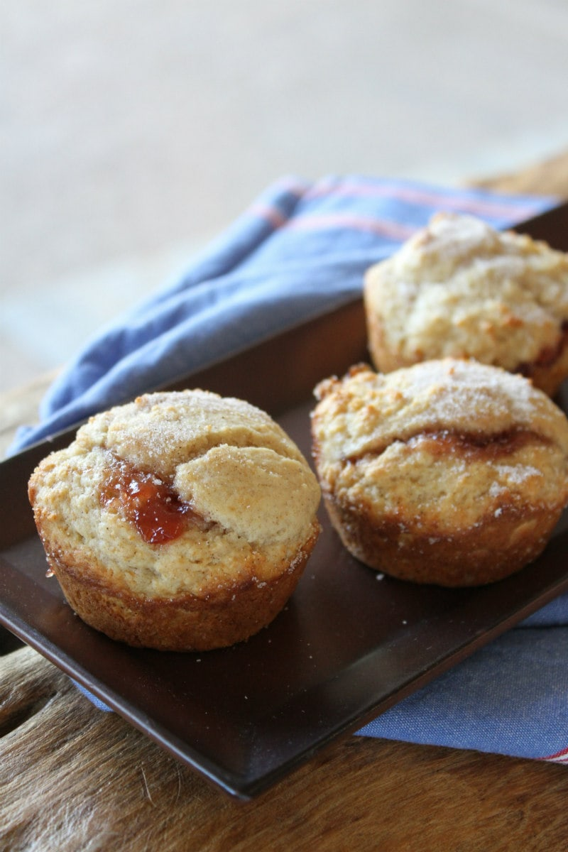 Low fat strawberry cinnamon muffins on a brown tray with a blue napkin