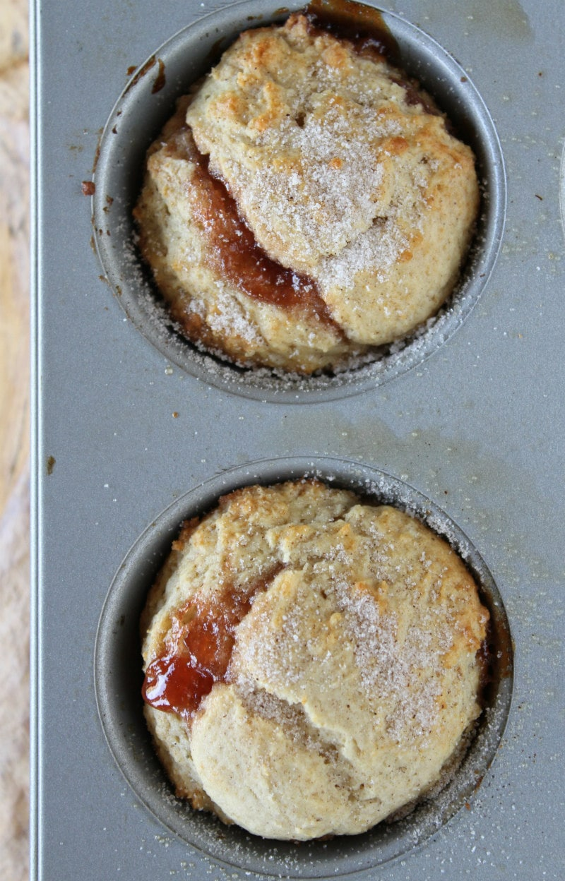 overhead shot of strawberry cinnamon muffins in a muffin tin