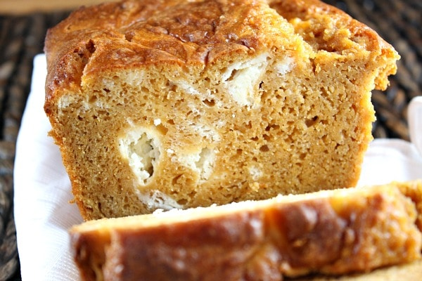loaf of pumpkin cream cheese swirl bread sliced open