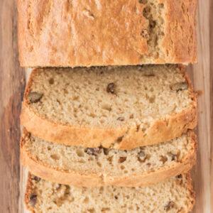 loaf of sour cream maple bread cut on cutting board