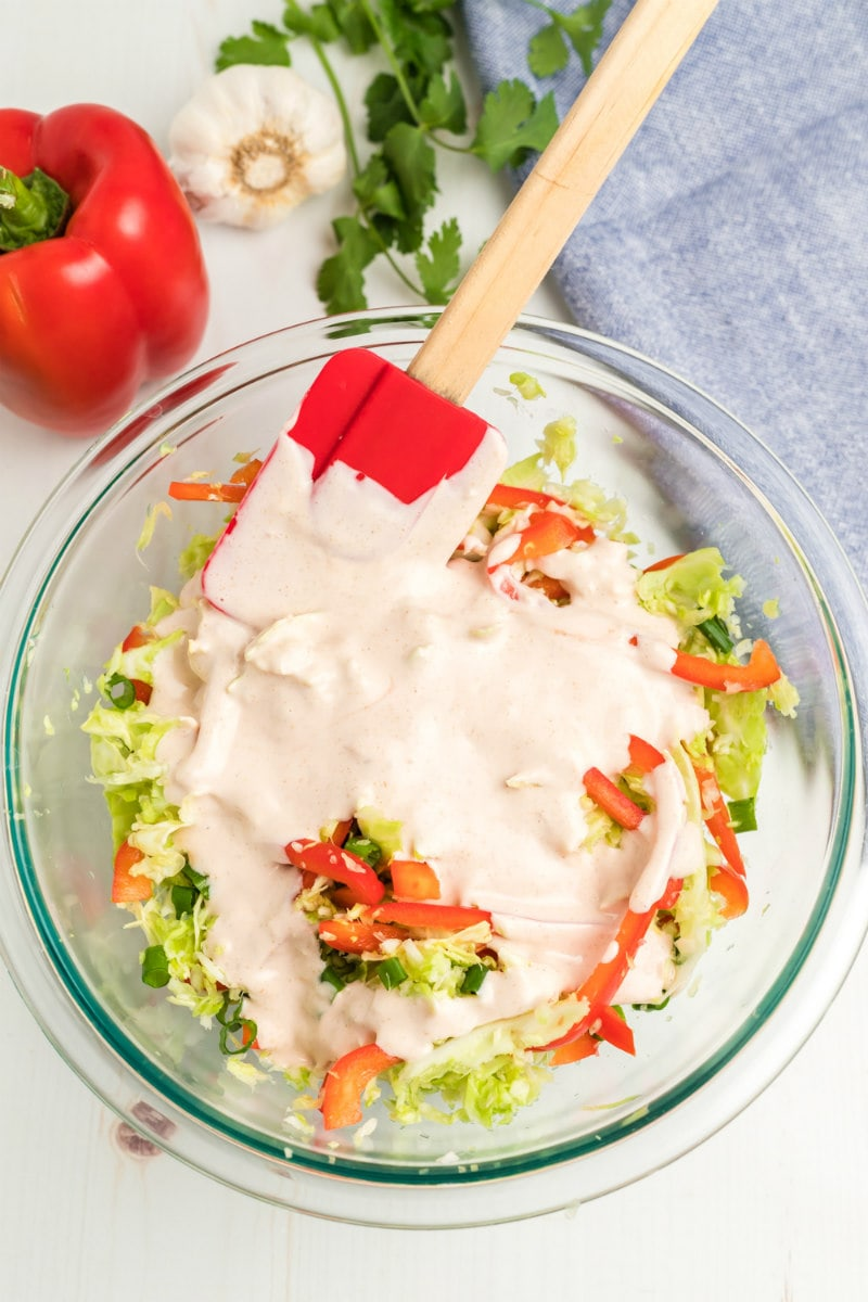Adding dressing to Mexican Coleslaw