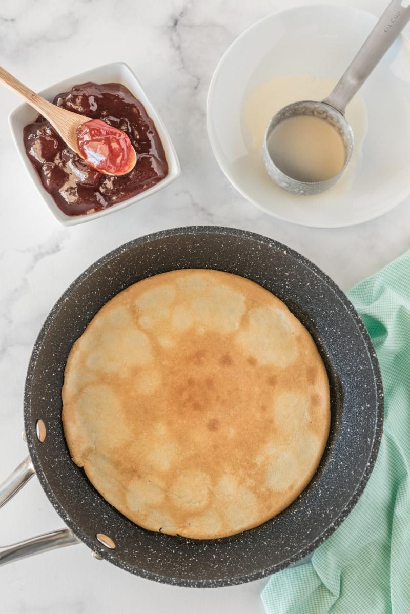 cooking pancakes in a pan