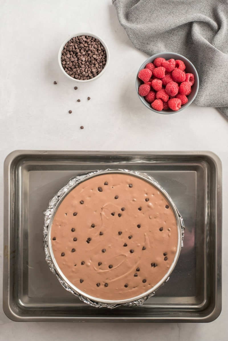 chocolate chip cheesecake in water bath ready for oven