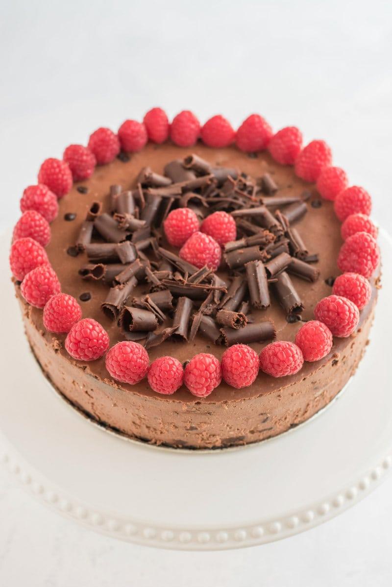 chocolate chocolate chip cheesecake with raspberry garnish