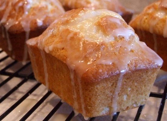 miniature lemon pound cake with glaze on a cooling rack