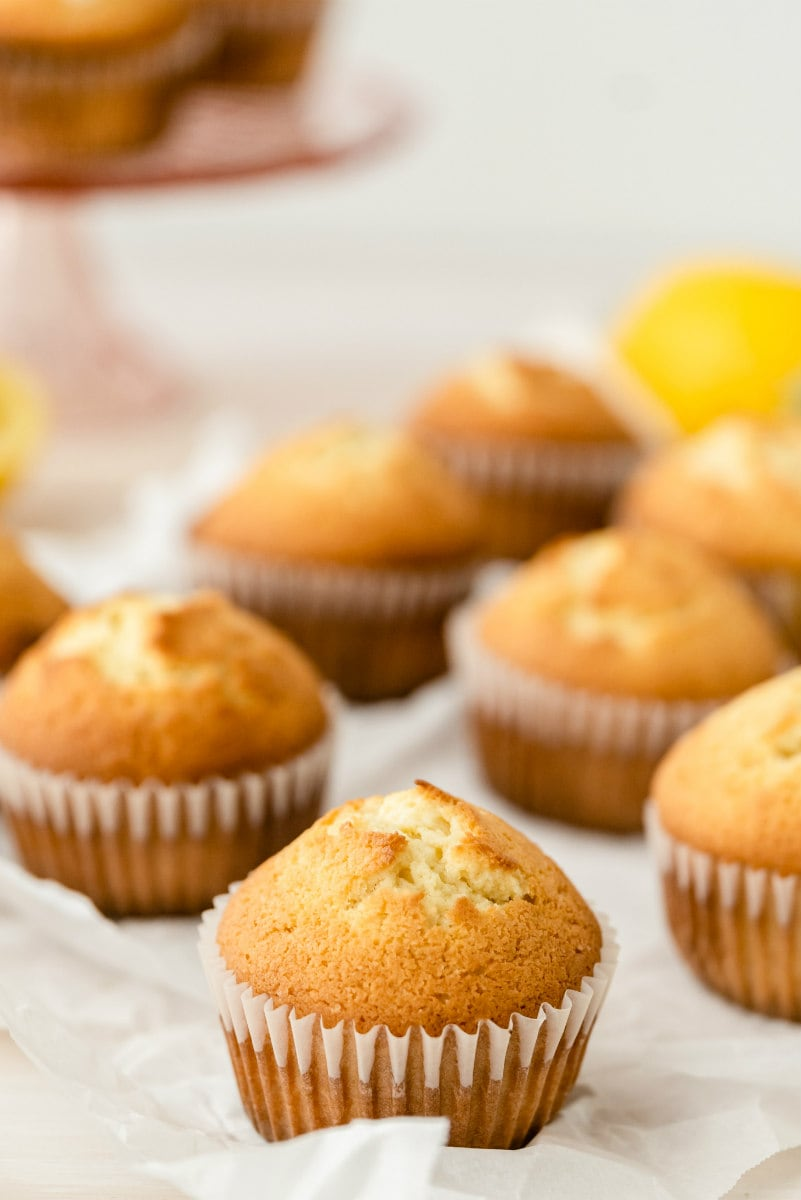lemon pound cake muffins displayed with a raised display of muffins in the background