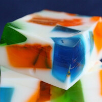 stacked pieces of sea glass jello with a blue background