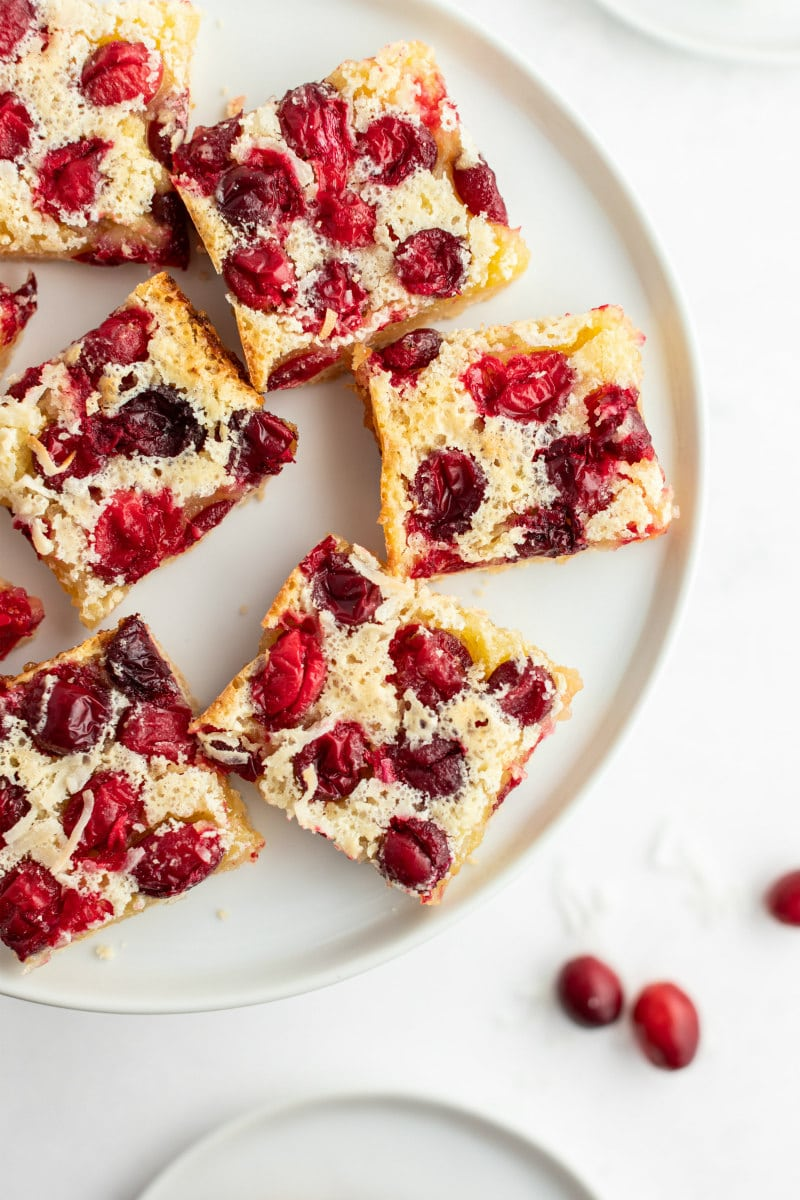 cranberry coconut squares on a white platter