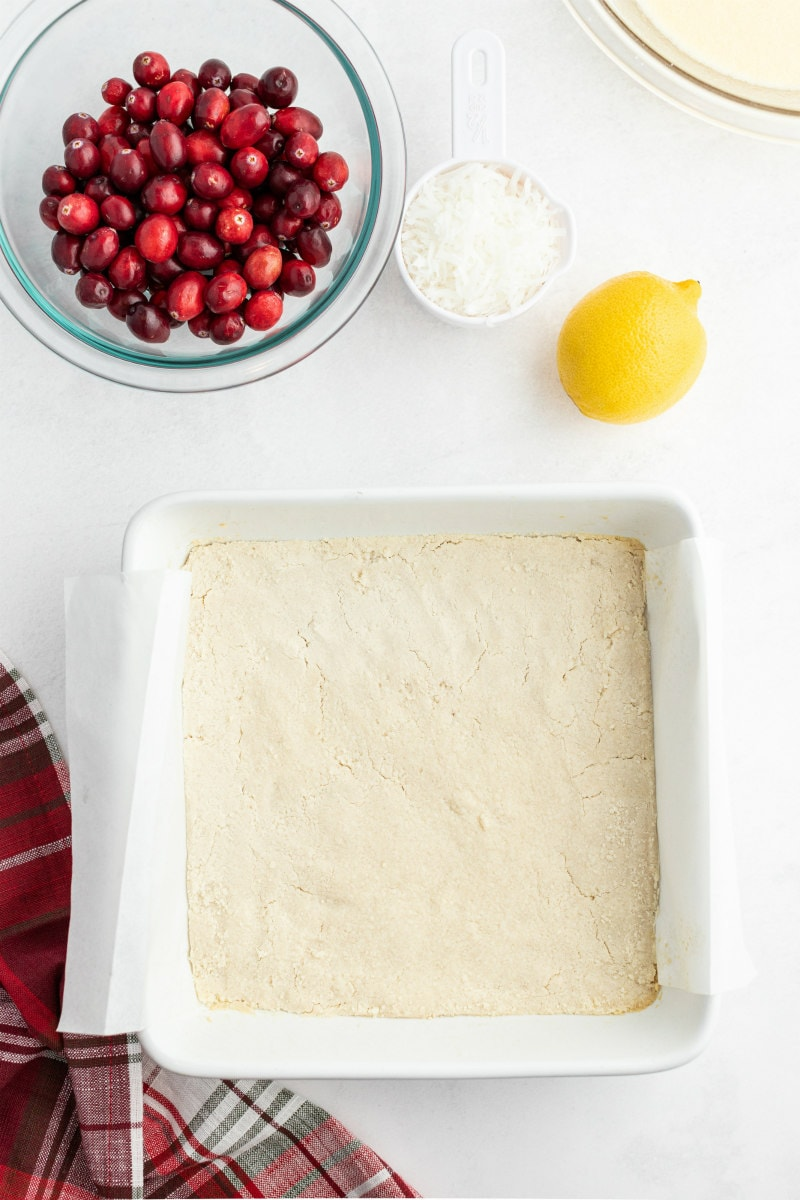 process of making cranberry coconut squares crust in pan