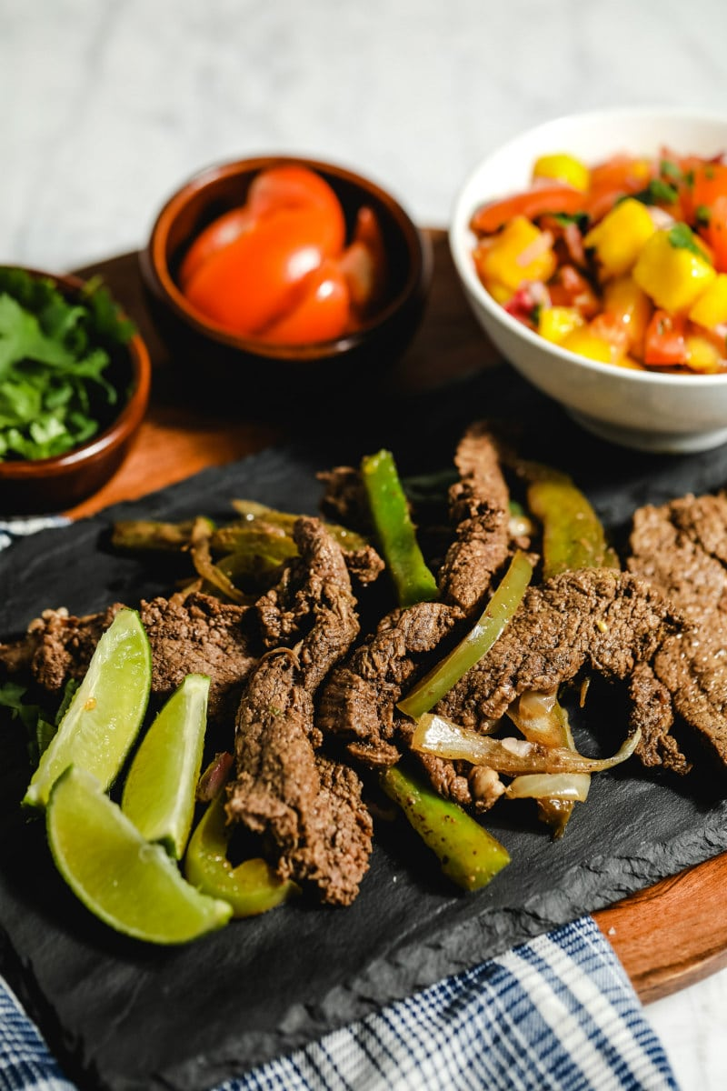 beef fajitas on a serving platter