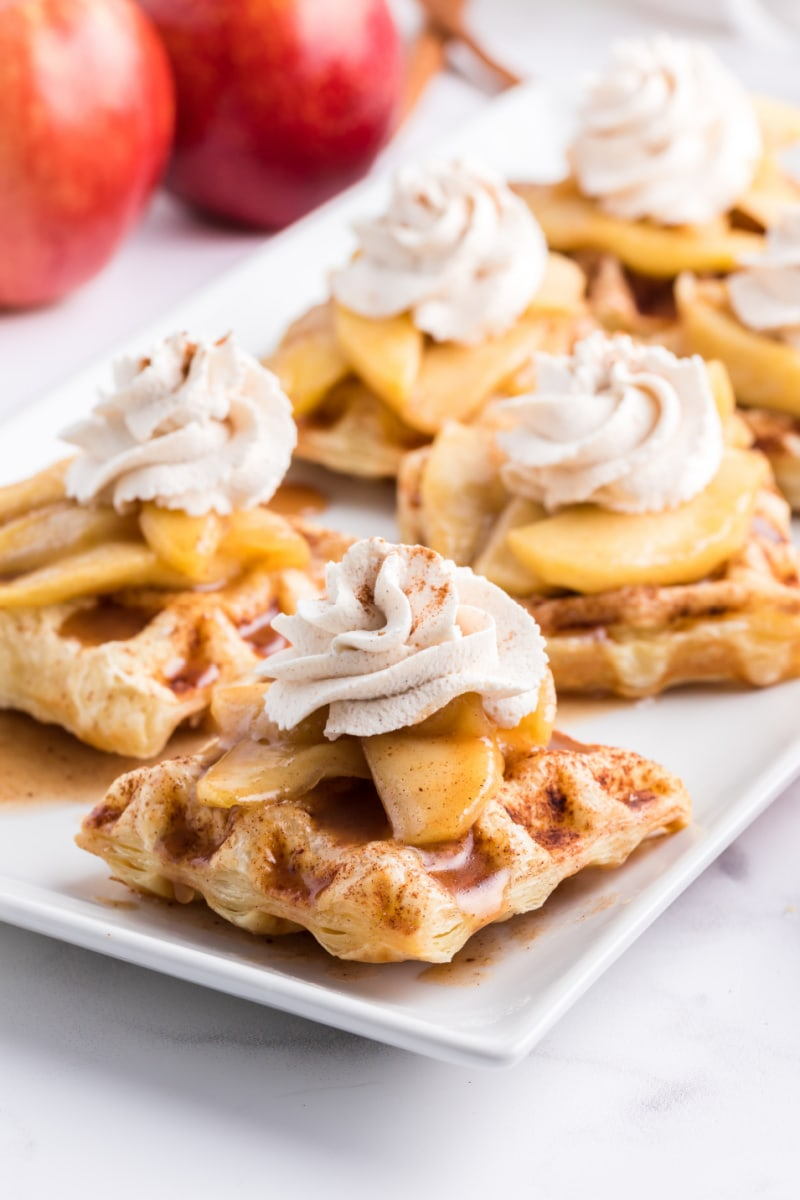 caramelized apple waffle pastries on white plate