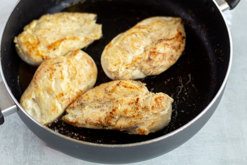 Chicken cooking in a skillet