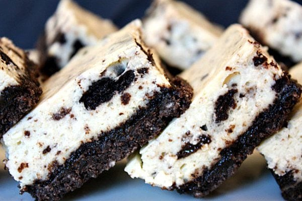 cookies and cream cheesecake bars stacked sideways