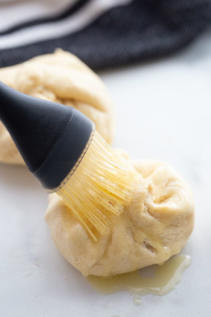 brushing croissant chicken with butter