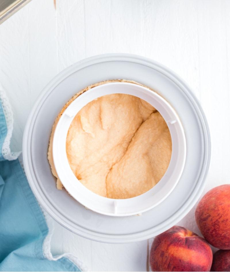 fresh peach ice cream churning in ice cream maker