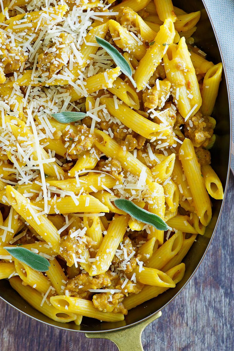 Pasta with Pumpkin and Sausage, topped with shredded Parmesan cheese