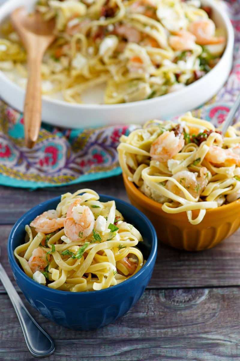 bowls of pasta with shrimp and feta