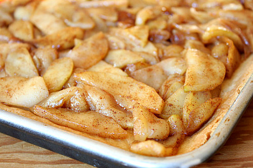 How to Make Apple Pie Bars - add the spiced apple filling