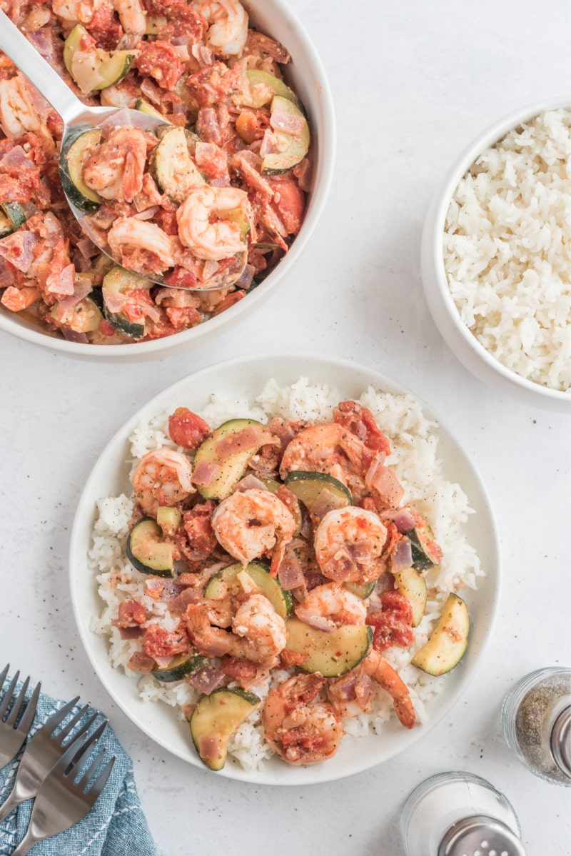 greek shrimp over rice on a white plate