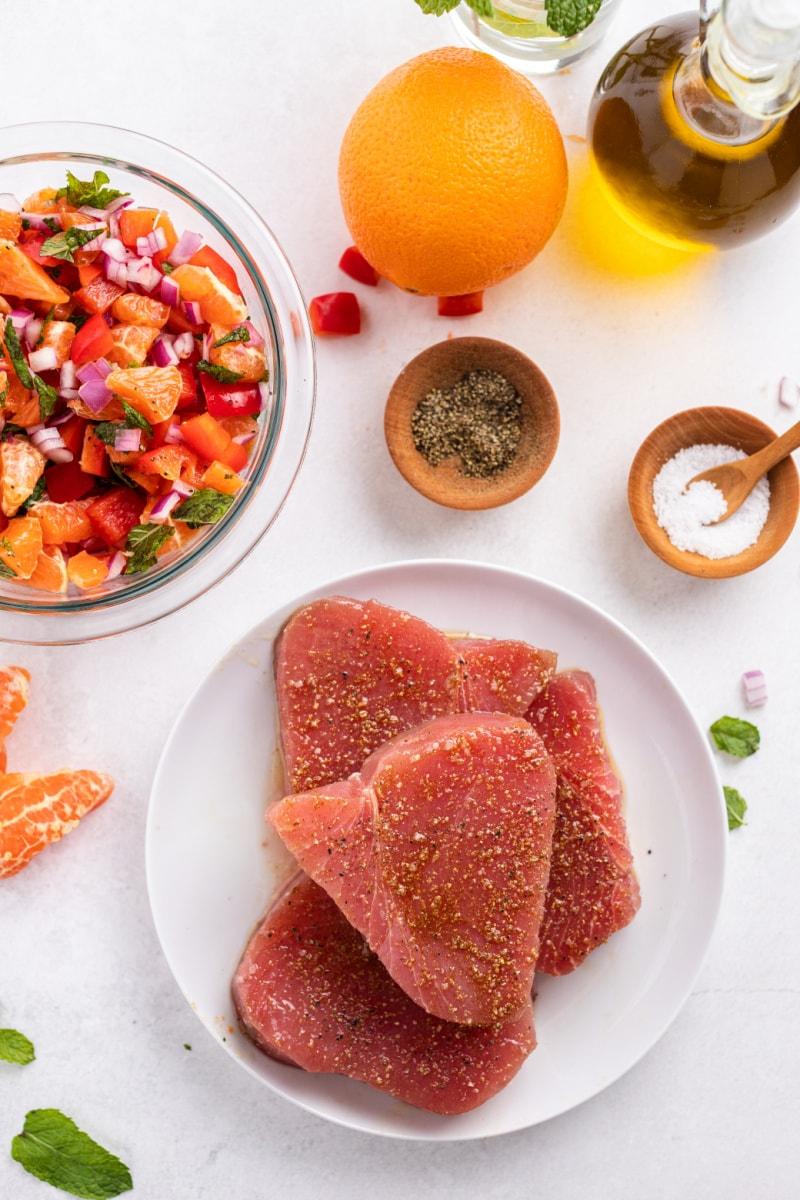 seasoned fresh tuna on a white plate