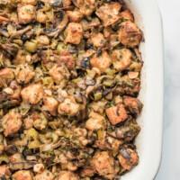 wild mushroom stuffing in a white casserole dish
