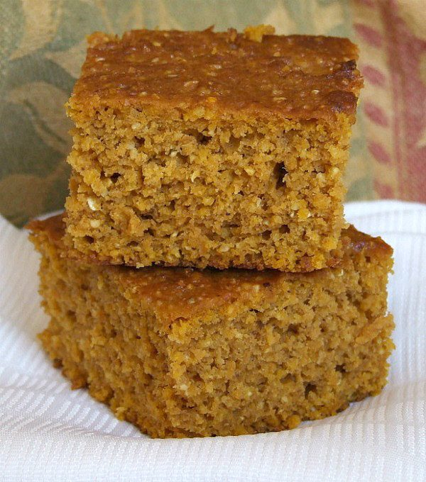 two slices of Pumpkin Cornbread stacked