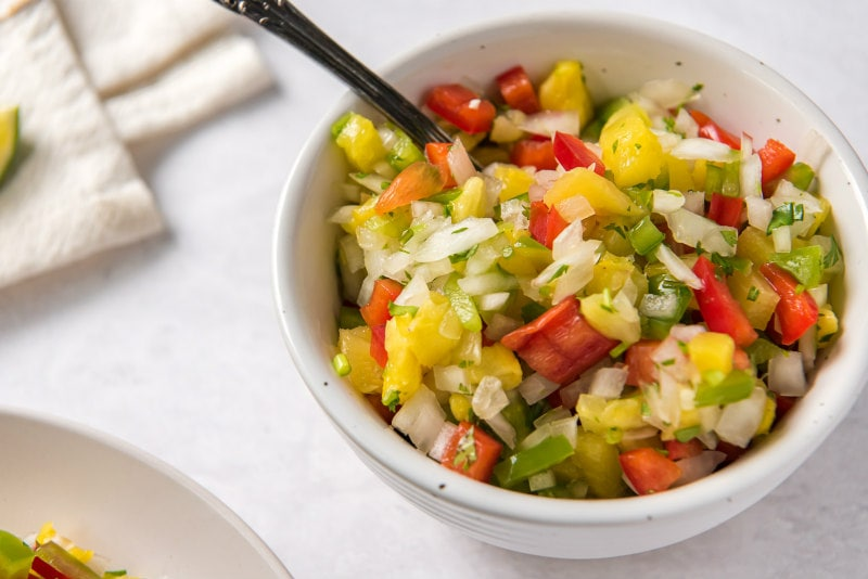 pineapple salsa in a white bowl