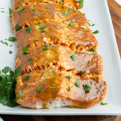 white tray with salmon with mustard and brown sugar glaze