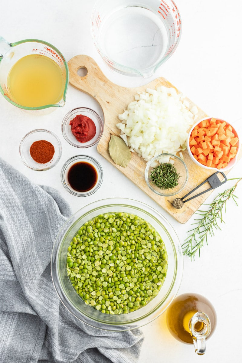 ingredients for split pea soup displayed in bowls