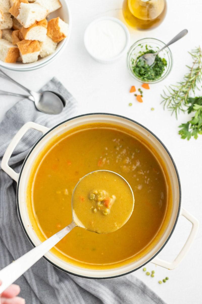 pot of split pea soup ladled out