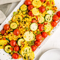 summer squash with cherry tomatoes on a platter