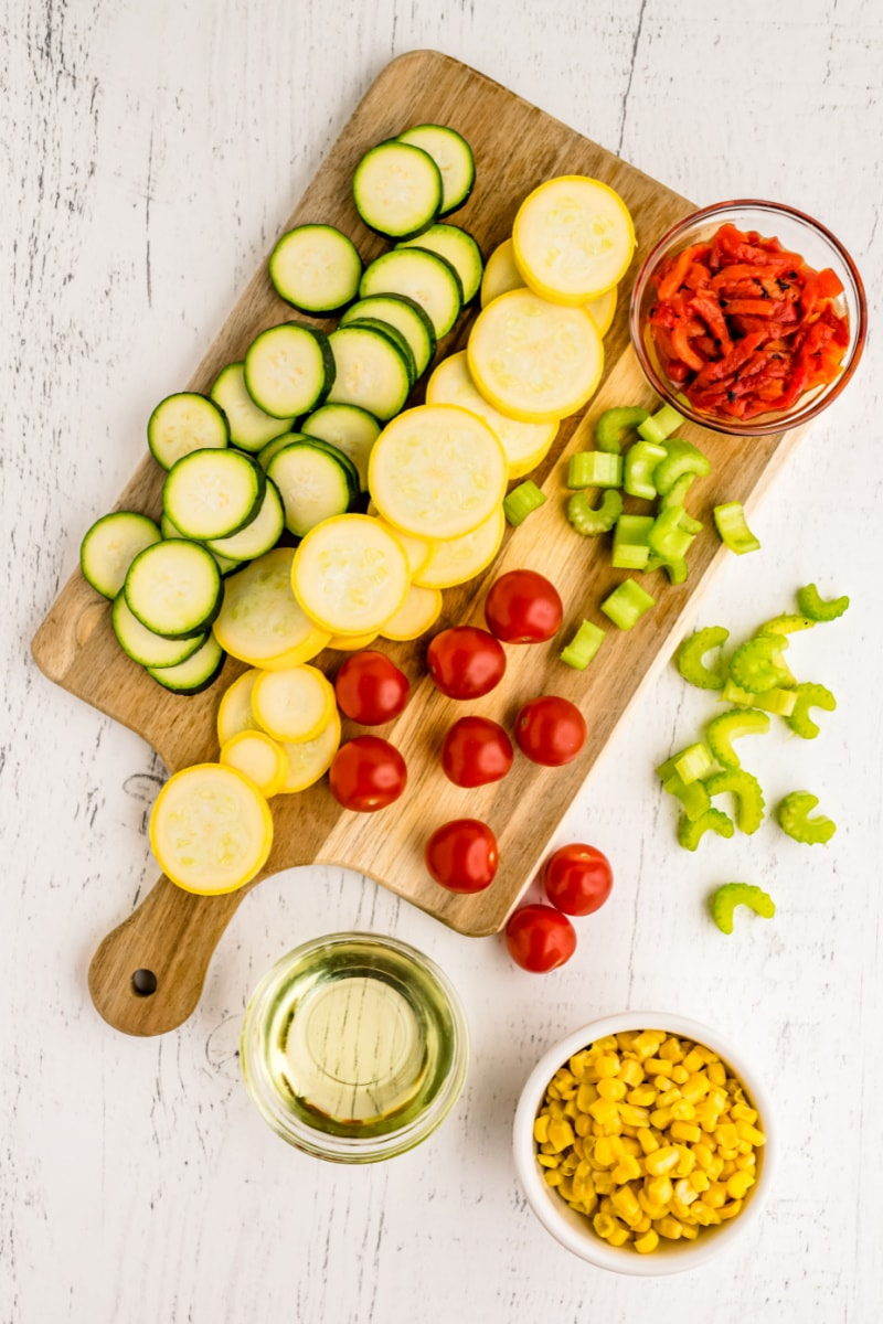 ingredients displayed for summer squash with cherry tomatoes